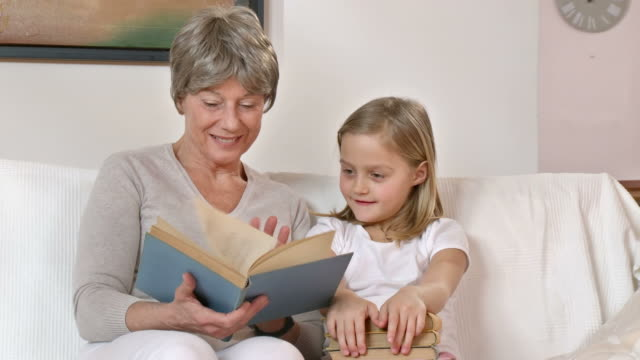 HD DOLLY: Granny Reading Book With Granddaughter