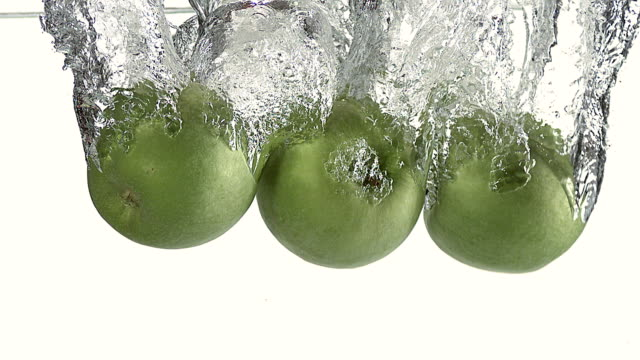 CU SLO MO Granny Smith Apples (malus domestica) entering water / Vieux Pont, Normandy, France