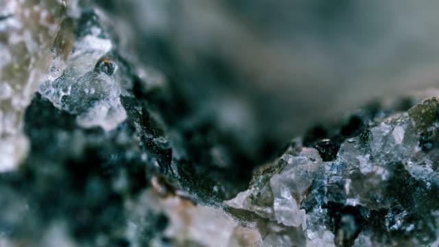 granodiorite mineral sample under light microscopy - gemology stock videos & royalty-free footage