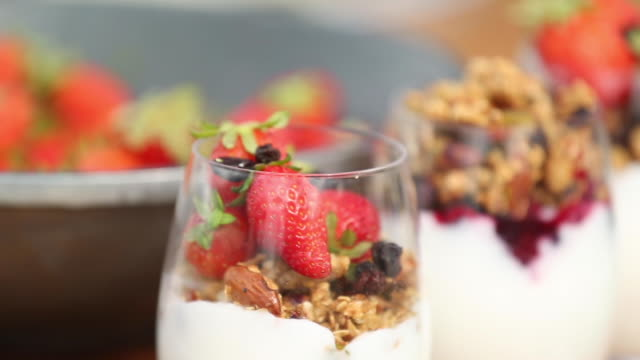 granola in yogurt with blueberries and strawberries
