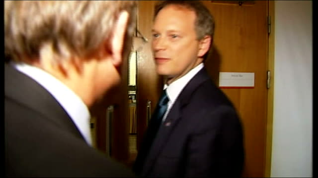 grant shapps admits holding second job while an mp 7102012 / t07101222 shot behind reporter as he follows shapps from hall and asking shapps if his... - grant shapps stock videos and b-roll footage