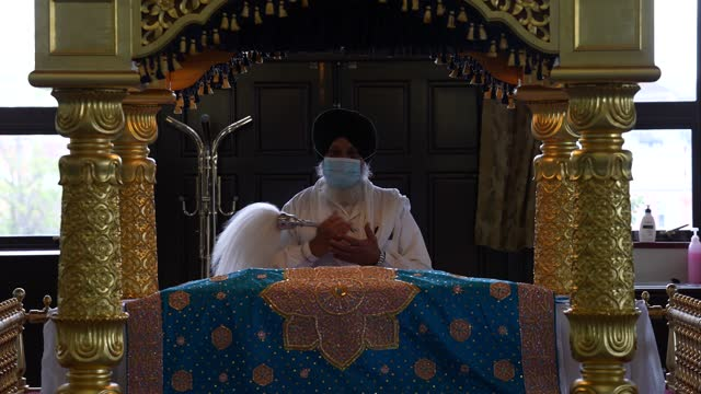 granthi wearing a face mask at the shrine at gurdwara sri guru singh sabha temple on may 27, 2021 in hounslow, england. the london borough of... - shrine stock videos & royalty-free footage