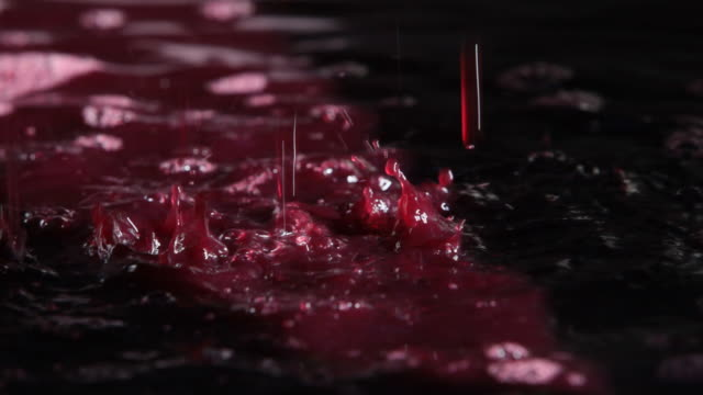Grape juice dripping from a press during the winemaking process.