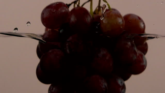 grape splashing into water (super slow motion) - grape stock videos & royalty-free footage