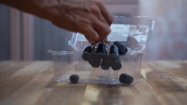 grapes fruit and plastic container - plastic container stock videos & royalty-free footage