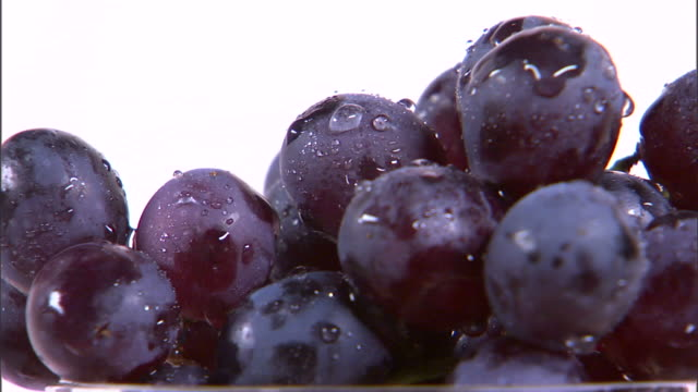 stockvideo's en b-roll-footage met cu grapes rotating against white background / orem, utah, usa - table top shot