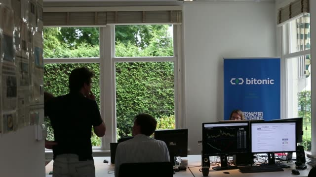 A graph tracking the Bitcoin exchange rate is displayed on a computer in the offices of Bitonic BV a Bitcoin trading company in Baarn Netherlands on...