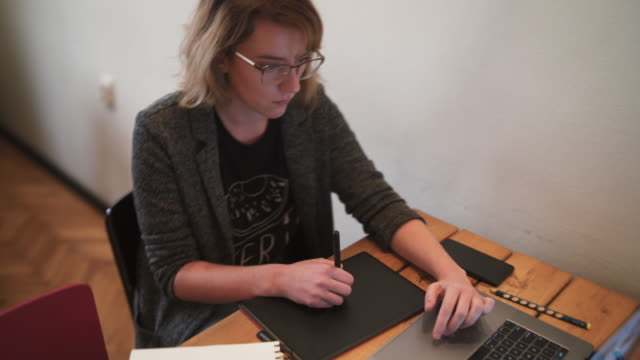Graphic designer works on a graphic tablet