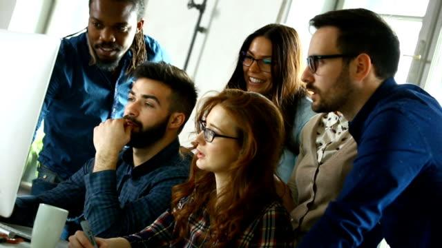 Graphic designers at their studio.