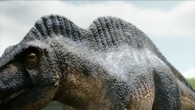 a graphic portrays a dinosaur hunting near a lake. - testa di animale video stock e b–roll