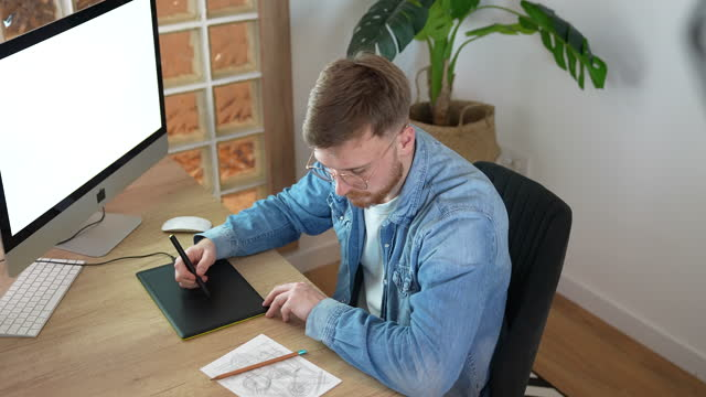 graphics designer working at home - desk stock videos & royalty-free footage