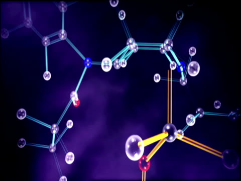 stockvideo's en b-roll-footage met graphics of revolving molecular structure with new chemical fusion against a purple background - versmelten