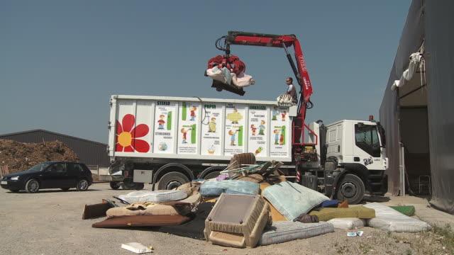 ws grapple truck relocating waste in dump yard, vrhnika, slovenia - vrhnika stock videos & royalty-free footage