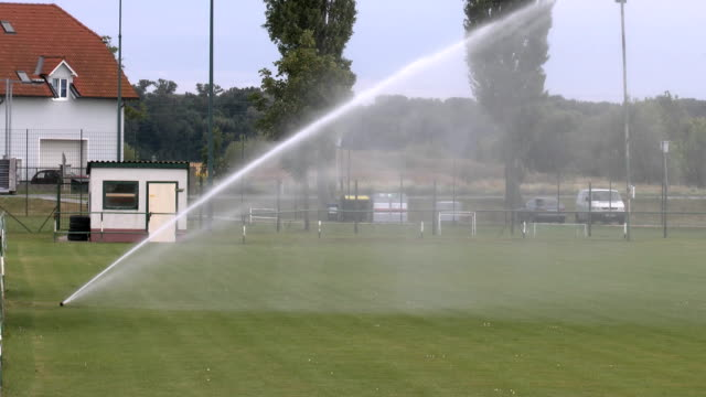 grass sprinkler - football pitch stock videos & royalty-free footage