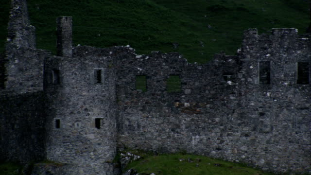 a grassy field surrounds the ruins of kilchurn castle. available in hd. - kilchurn castle stock videos and b-roll footage