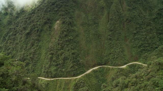 grassy mountains with trail - gebäudefries stock-videos und b-roll-filmmaterial