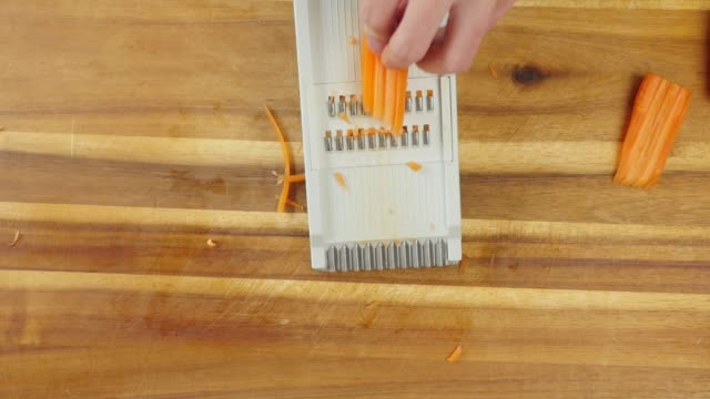 grate carrots using a food grater - grater utensil stock videos & royalty-free footage