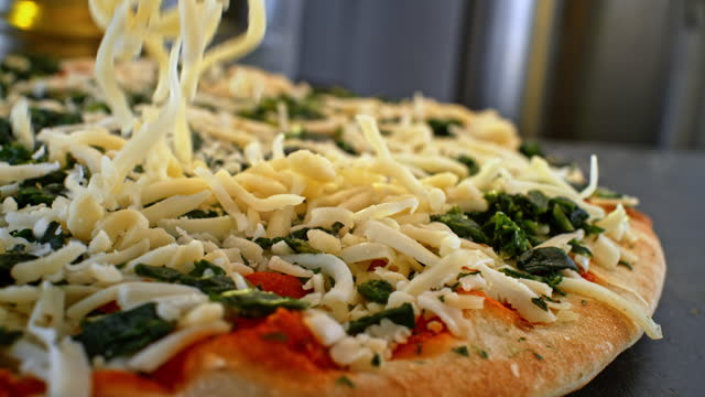 slo mo grated cheese falling onto a pizza - cheese stock videos & royalty-free footage