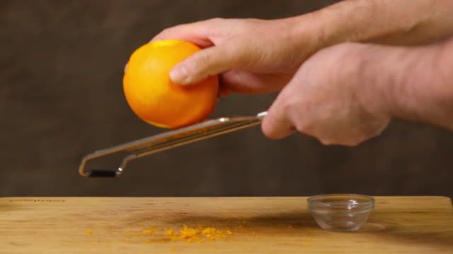 grated orange zest. - citrus fruit stock videos & royalty-free footage
