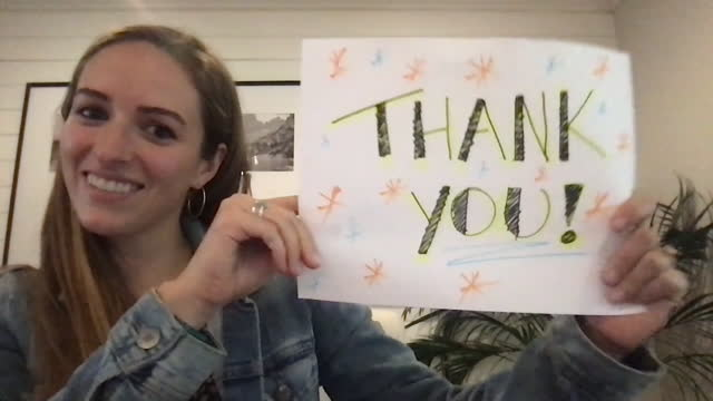 grateful woman smiles, holds thank you sign during video call - drawing activity stock videos & royalty-free footage