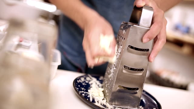 grating cheese - grater utensil stock videos & royalty-free footage