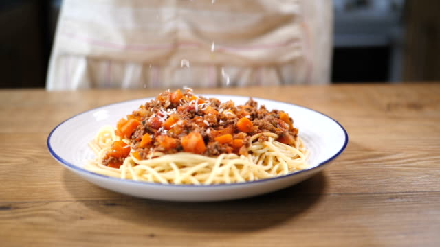 grating parmesan cheese on spaghetti bolognese - spaghetti bolognese stock videos & royalty-free footage