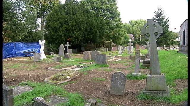 Grave excavated in search for missing Lee Boxell ENGLAND London Sutton Cheam EXT General view St Dunstan's church PAN graveyard to where police...