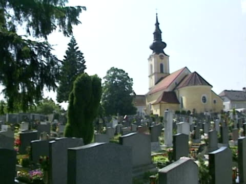 / grave site of hitler's parents alois and klara at the cemetery in the village of leonding outside linz / the tombstone no longer exists it was... - grab stock-videos und b-roll-filmmaterial
