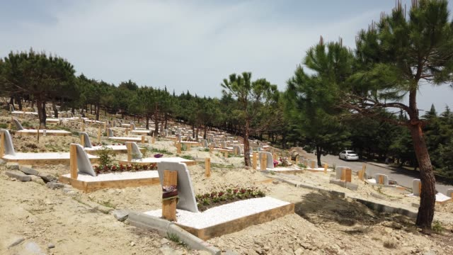 grave sites of coronavirus victims are seen at a designated burial site inside kilyos cemetery on may 16, 2020 in istanbul, turkey. with 16 million... - funeral stock videos & royalty-free footage