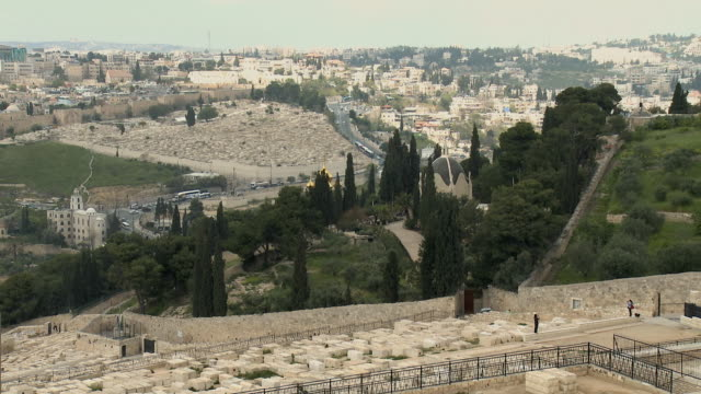 ws ha grave stones on mount of olives with dominus flevit church in background / jerusalem, israel - human settlement stock videos & royalty-free footage