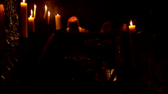 gravediggers in medieval clothing push a cart loaded with human remains and tools in a paris sewer. - reenactment stock videos & royalty-free footage