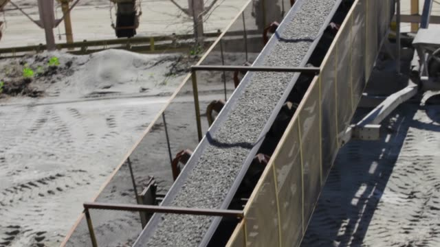 gravel pit conveyer belt - miniera video stock e b–roll