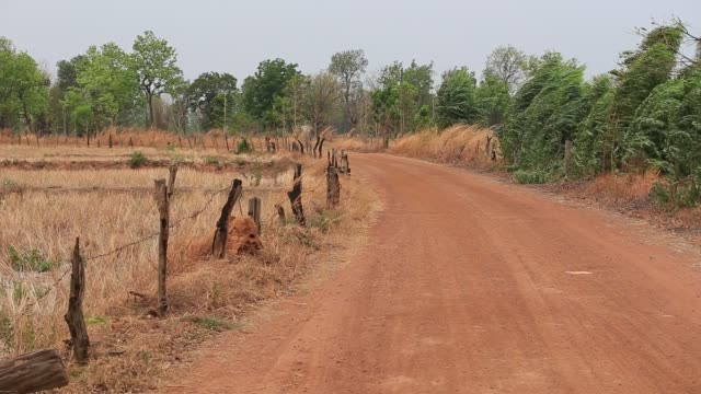 Gravel Road (unpaved road) in rural area at Thailand
