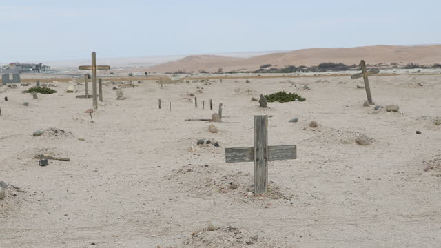 graves marked with wooden crosses stand at the historic herero cemetery next to the swakopmund concentration camp memorial, in honor of the... - 植民地様式点の映像素材/bロール