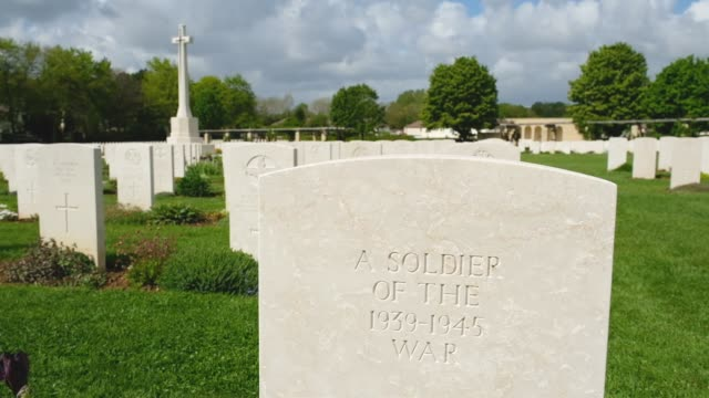 graves of mostly british soldiers killed in the world war ii allied invasion of normandy lie at the commonwealth war graves commission's ranville war... - d dagen bildbanksvideor och videomaterial från bakom kulisserna