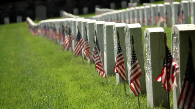 gravestones at a veteran cemetery in brooklyn - us memorial day stock videos & royalty-free footage