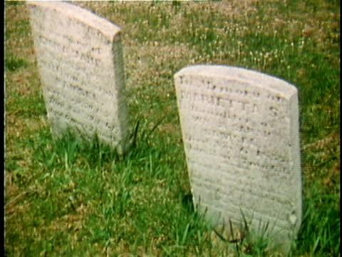1971 reenactment montage gravestones in cemetry / 19th century united states / audio - 礎石点の映像素材/bロール