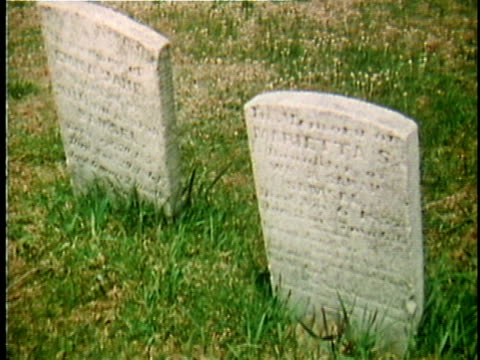 1971 reenactment montage gravestones in cemetry / 19th century united states / audio - gravestone stock videos & royalty-free footage