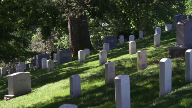 Gravestones on a hillside in Arlington National Cemetery. Shot in May 2012.