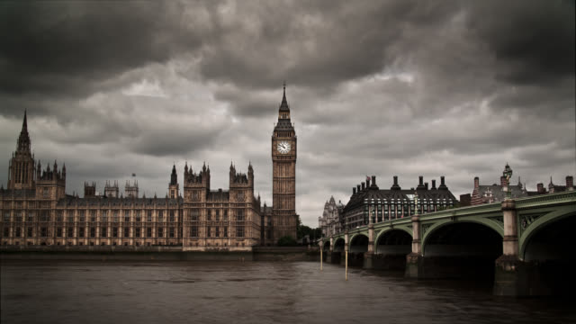 gray clouds float over big ben and westminster palace in london, england. - big ben stock videos & royalty-free footage