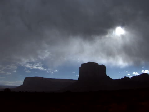 gray clouds over butte - butte rocky outcrop stock videos & royalty-free footage