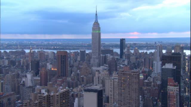 gray new york city over queensboro bridge - b roll stock videos & royalty-free footage