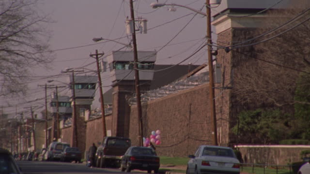 vidéos et rushes de a gray, stone church stands across from a city jail. - new jersey