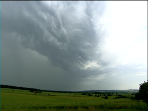 gray stormy clouds move rapidly across sky bolt of lightning flashes in distance cotswolds - thunderstorm stock videos & royalty-free footage