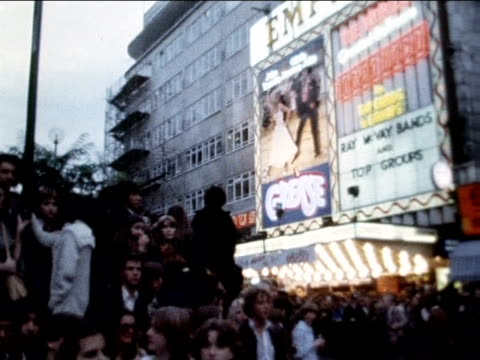 'grease' fans congregate outside empire cinema for premiere 13 september 1978 - 1978 stock videos & royalty-free footage