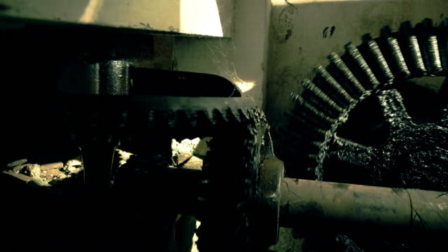 greasy big gears in an old factory - lubrication stock videos & royalty-free footage