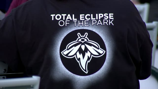 'Great American Eclipse' crosses 14 states from coast to coast USA South Carolina Columbia EXT Baseball glove and players on pitch Player pitching...