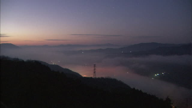 great amount of fogs flowing onto the hiji river. - electricity pylon stock videos & royalty-free footage