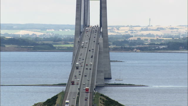 great belt bridge (centre section)  - aerial view - zealand, denmark - denmark stock videos & royalty-free footage