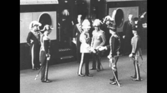 great britain's king george v and king faisal of iraq meet and shake hands on train platform at victoria station; faisal also meets edward, prince of... - headdress stock videos & royalty-free footage